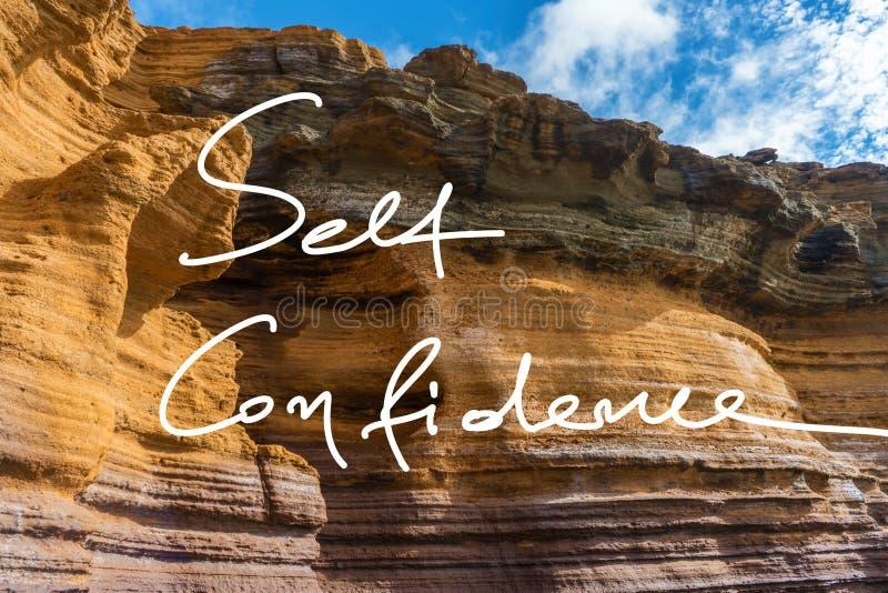 Självförtroendehandskriftmotto på ett foto arkivbild