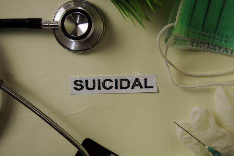 Självmords- med inspiration och sjukvård/medicinskt begrepp på skrivbordbakgrund royaltyfri foto