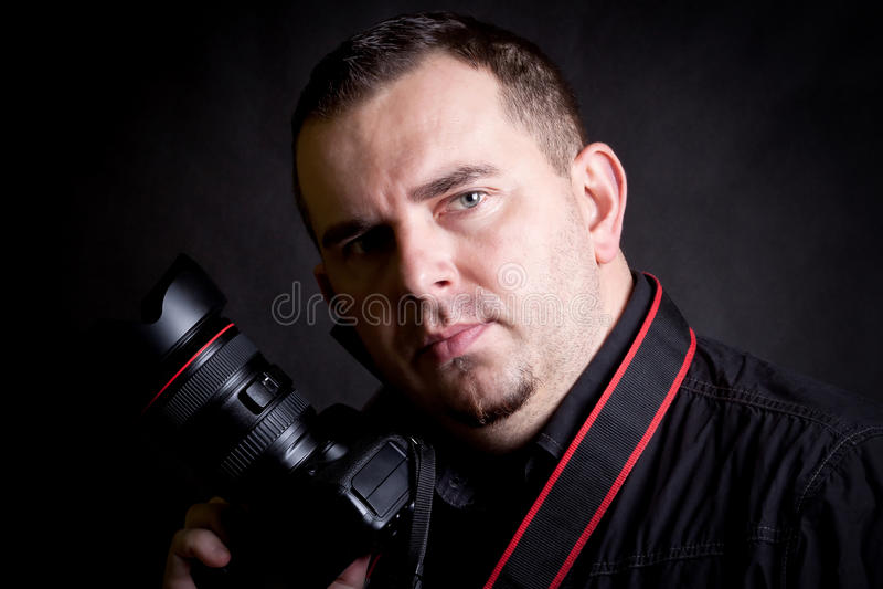 Självstående av fotografen med kameran