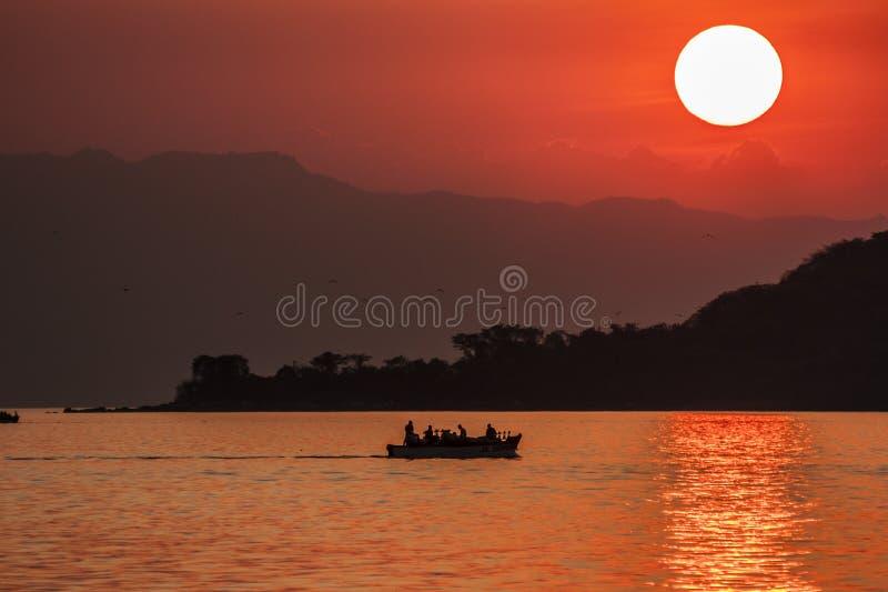 SjöMalawi solnedgång arkivfoto
