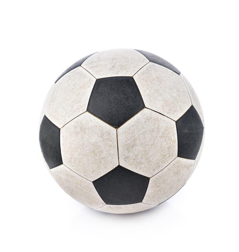 Sjaskig fotbollboll på vit bakgrund arkivbilder