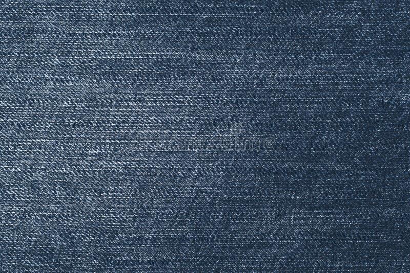 Sjaskig mörk grov bomullstvill f?r kl?ddenims f?r bakgrund bl? textur f?r jeans Tygmodellyttersida Gammal retro stil av jeankläde arkivfoton