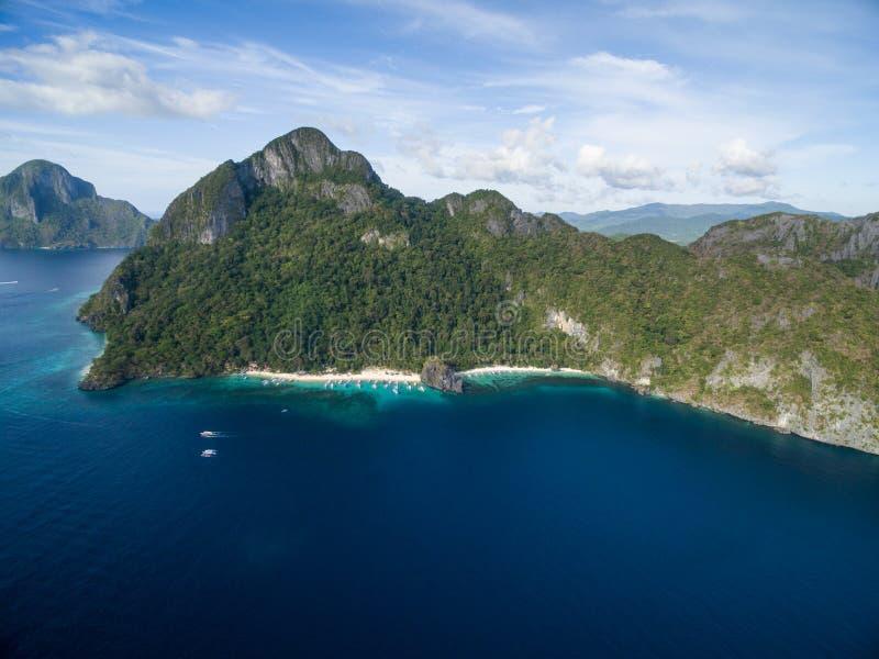 Sju kommandon strand och Papayastrand i El Nido, Palawan, Filippinerna Turnera a-rutten och förlägga royaltyfri fotografi