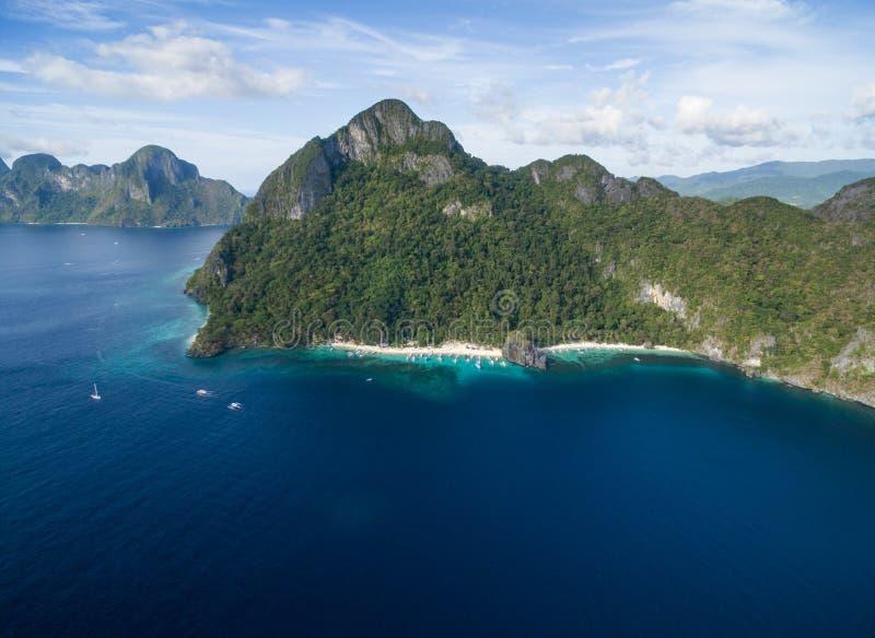 Sju kommandon strand och Papayastrand i El Nido, Palawan, Filippinerna Turnera a-rutten och förlägga arkivfoton