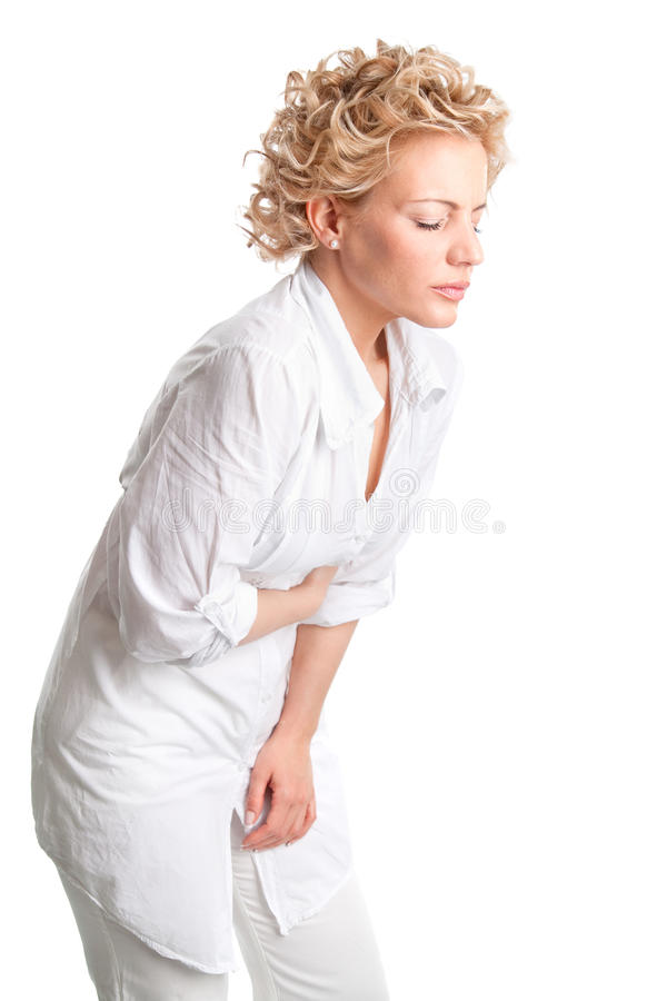Sjuk ung kvinna. Magen smärtar. arkivfoto