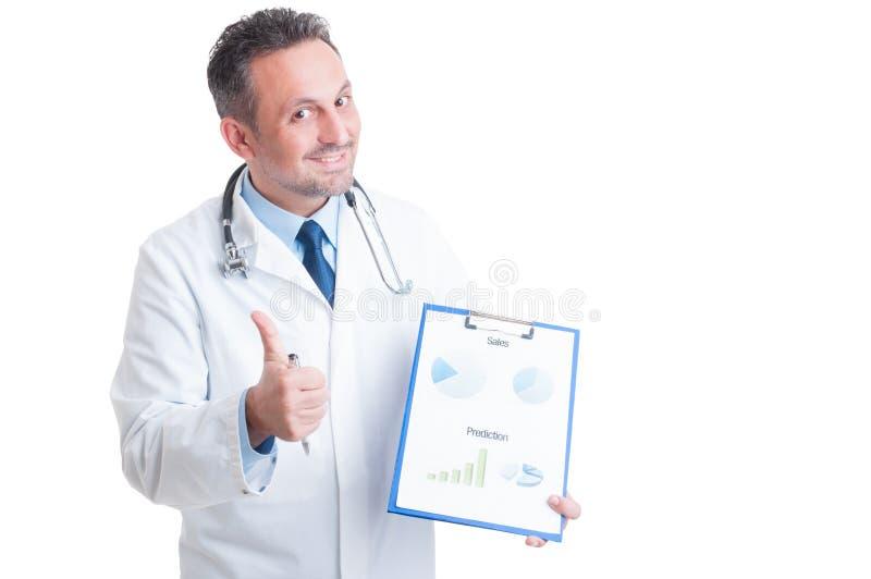 Sjukhuschefen som framlägger medicinförsäljningar, och finansiella förutsäger arkivfoton