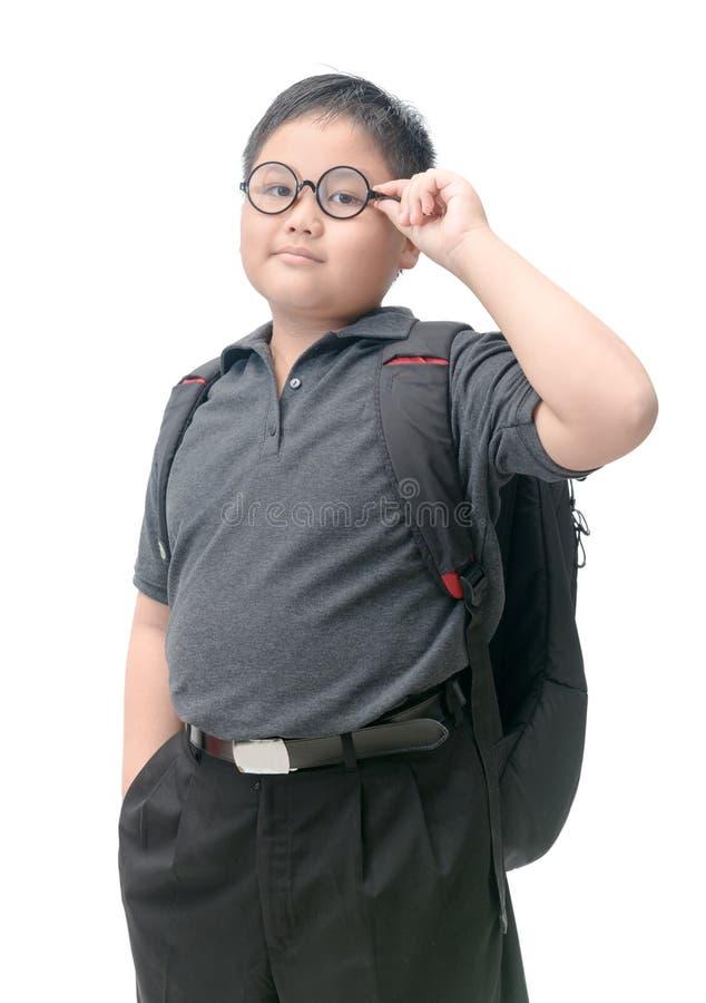 Sjukligt feta asiatiska studentkläderexponeringsglas med skolapåsen arkivfoton
