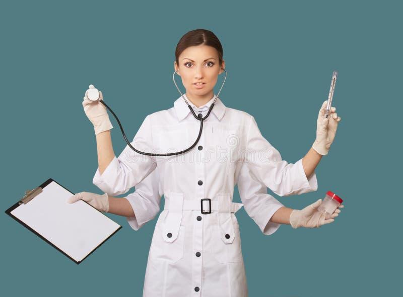 Sjuksköterska med många händer royaltyfri foto