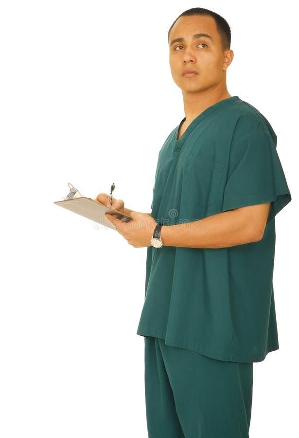 sjuksköterska som tänker till vad skriver royaltyfri bild