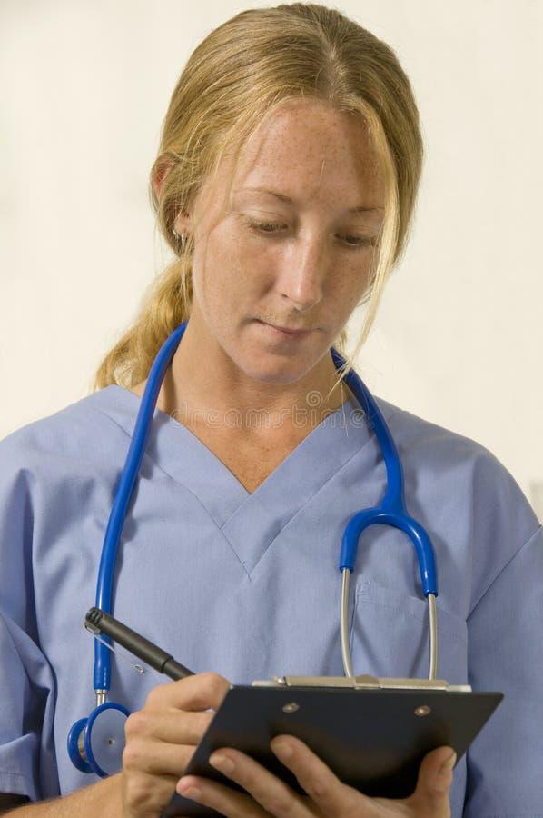 sjuksköterskareceptwriting royaltyfri fotografi
