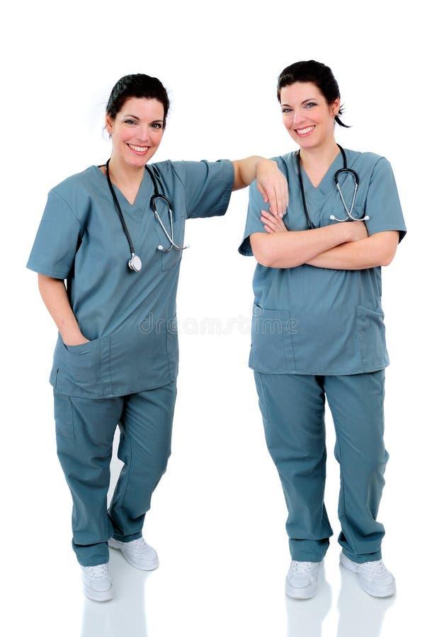 sjuksköterskor kopplar samman royaltyfria bilder