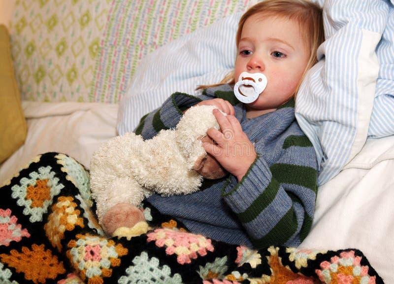 sjukt barn arkivfoto