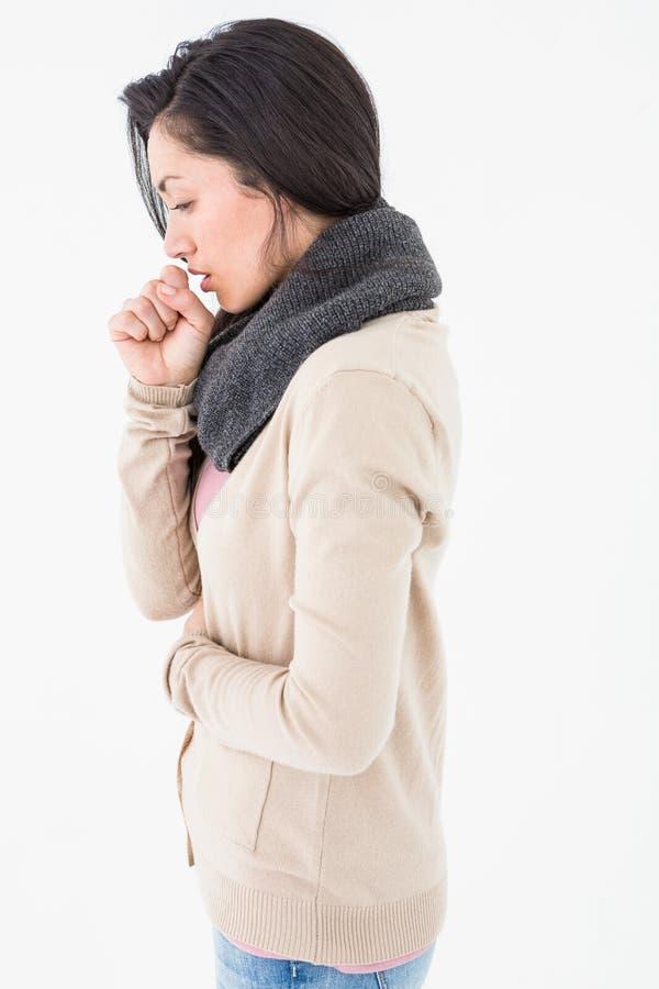 Sjukt hosta för brunett royaltyfri fotografi