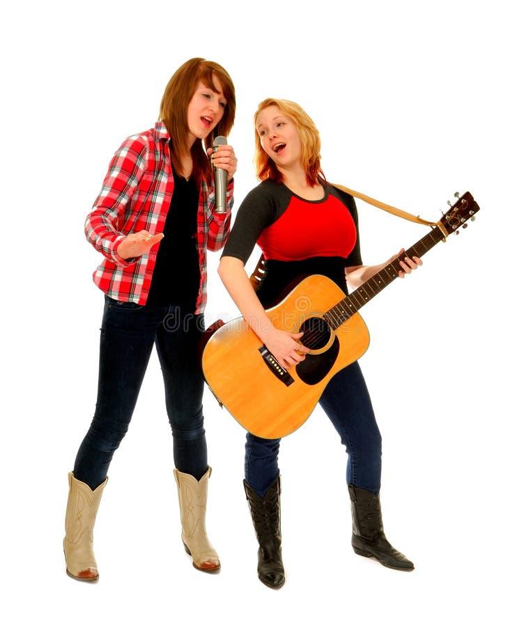 sjunga för landsduettkvinnlig royaltyfri bild
