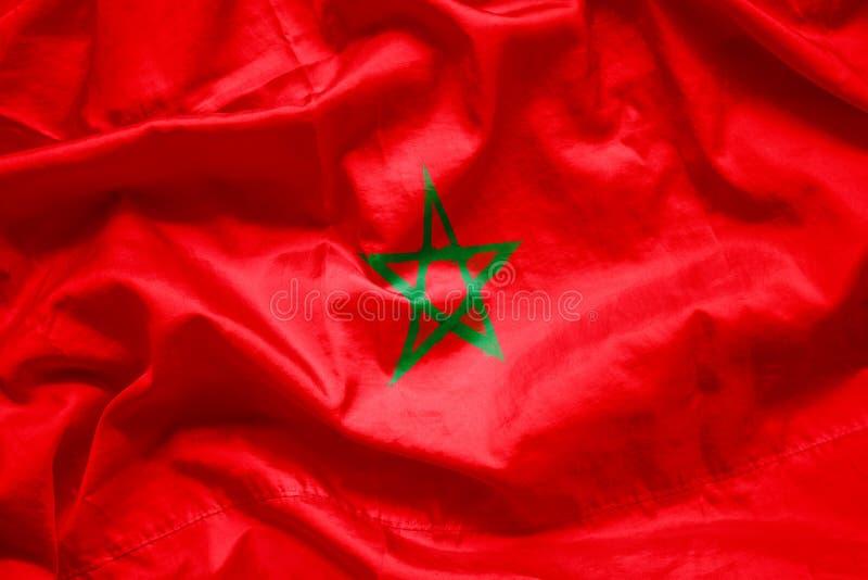 Sjunka kungariket av Marocko vid vattenfärgmålarfärgborsten på kanfastyg, grungestil royaltyfria foton