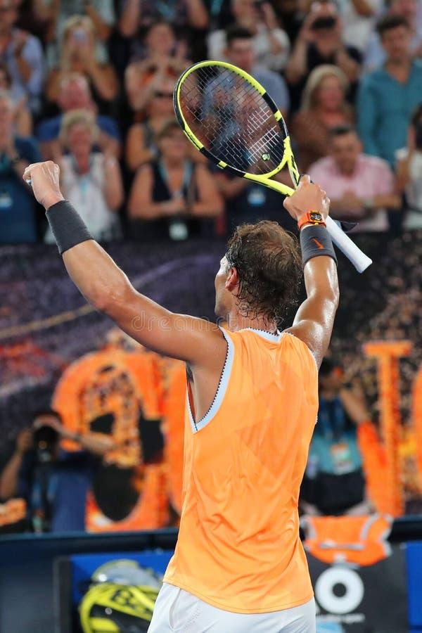 Sjutton gånger den Grand Slam som mästaren Rafael Nadal av Spanien firar seger efter hans semifinalmatch på australiska 2019, öpp royaltyfri bild