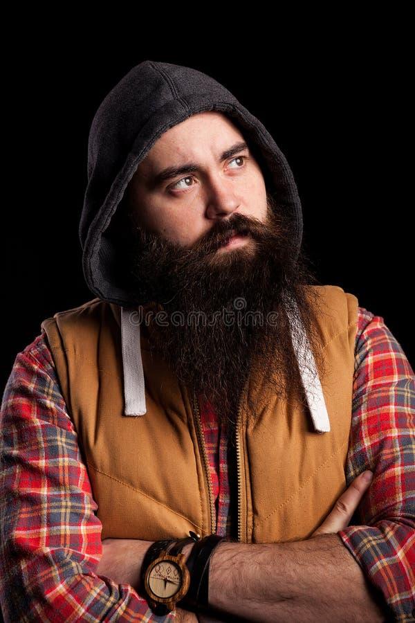 Skäggig hipsterman med det långa skägget royaltyfria bilder