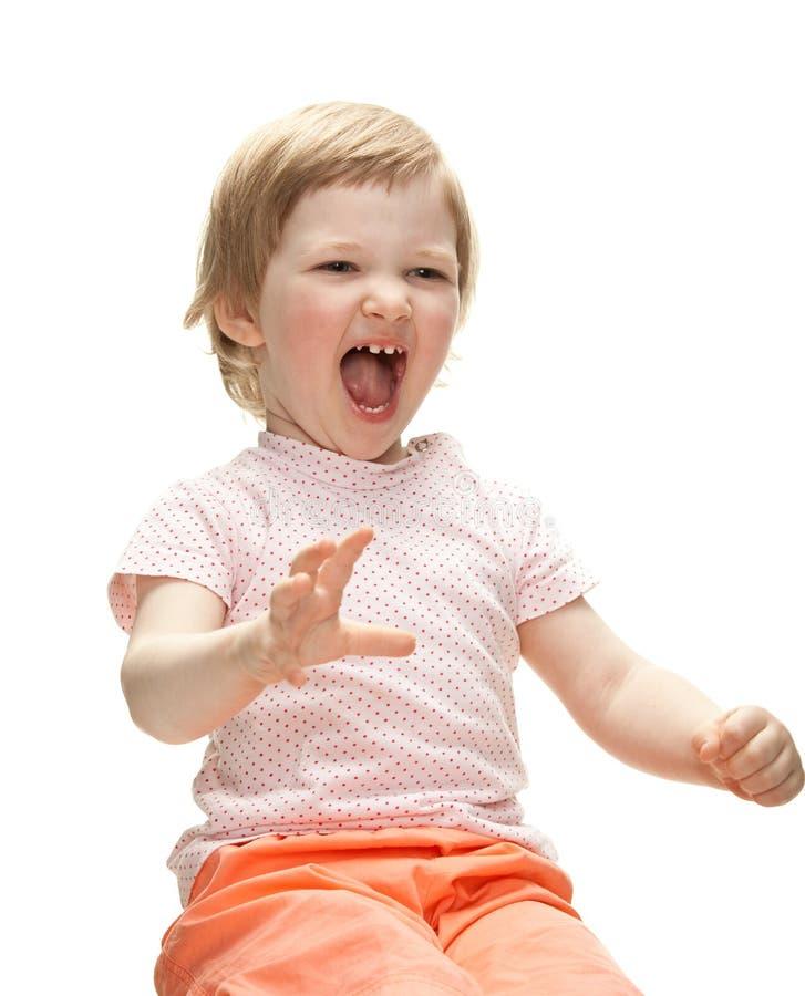 Skämtsamt skratta behandla som ett barn flickan royaltyfri foto