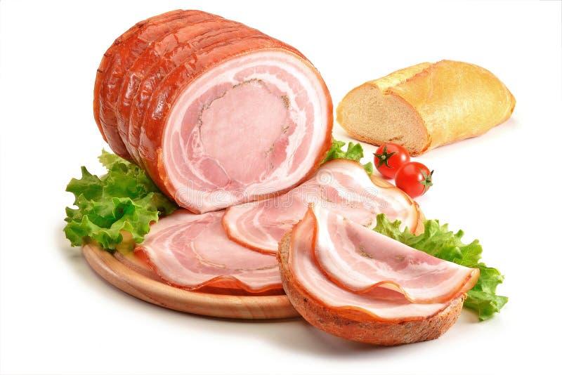 Skärbräda med stekgriskött och bröd royaltyfri foto