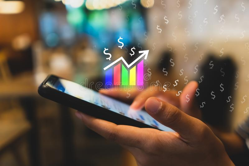 Skärm för symbol för marknadsmaterielgraf av smartphonebakgrund Finansiellt drömliv för affärsteknologifrihet genom att använda i royaltyfria foton