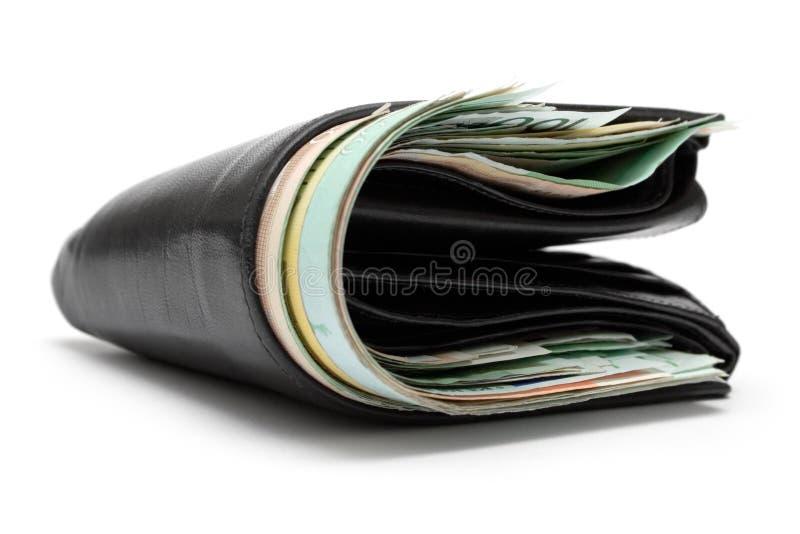 skóra wypchany portfel. zdjęcie stock