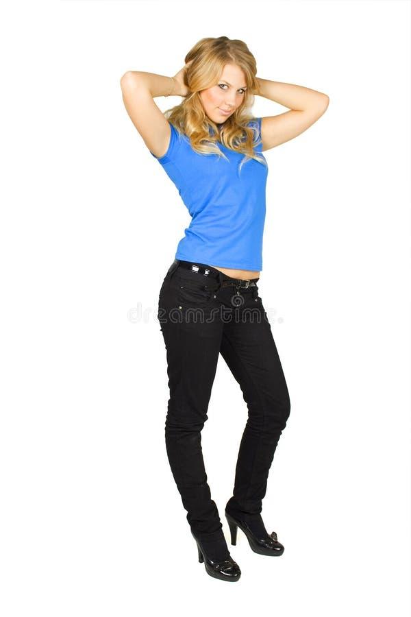 skönhet bak blond flicka hands den head standingen arkivfoto