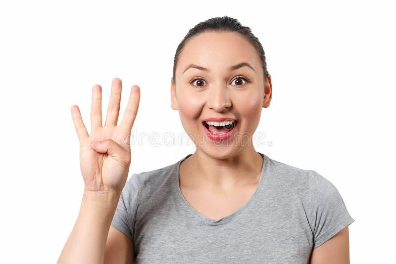 Skönhet som upp rymmer fyra fingrar, stående royaltyfria foton