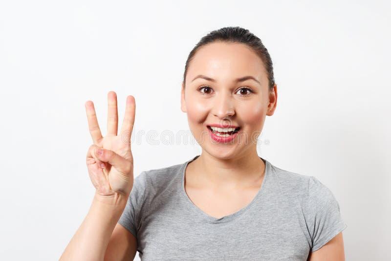 Skönhet som upp rymmer tre fingrar, stående royaltyfri fotografi