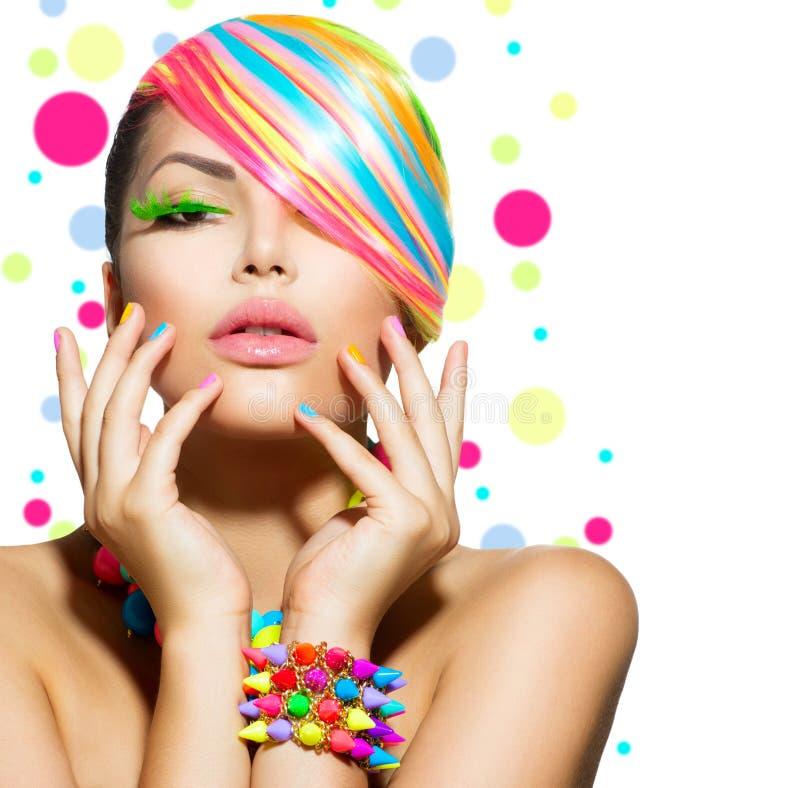 Skönhetflicka med färgrik makeup arkivfoto