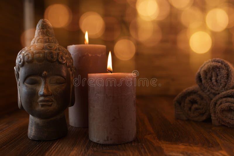 Skönhetwellnessstilleben med huvudet av buddha arkivbilder