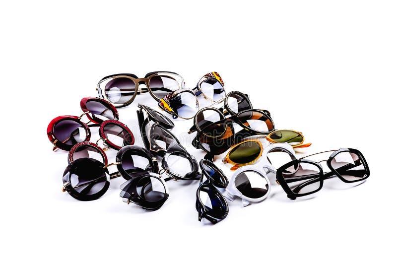 Skład kilka okulary przeciwsłoneczni na lekkim tle fotografia royalty free