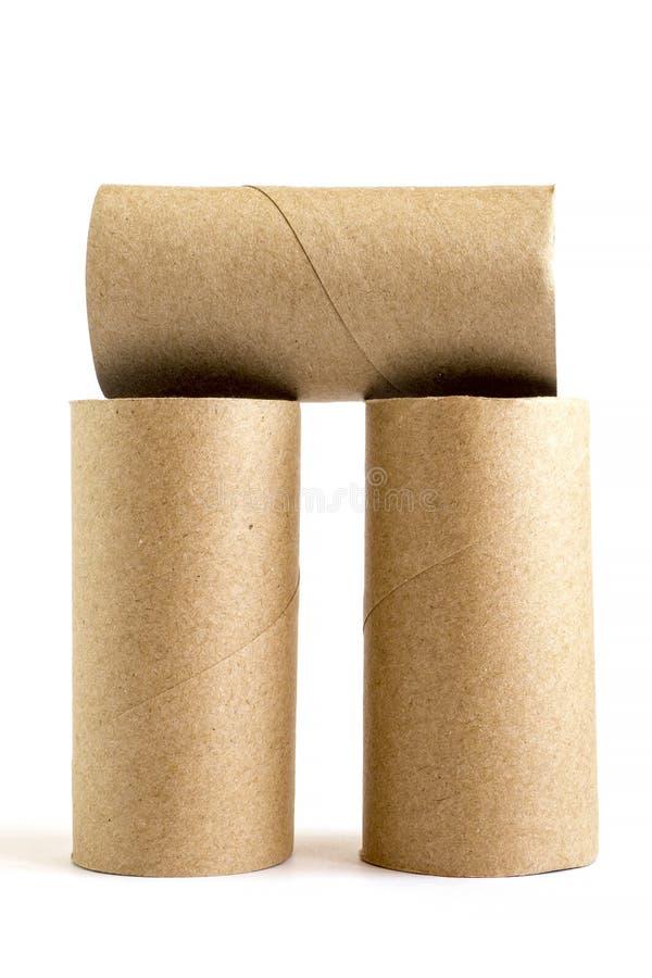 Skład od trzy karton papierowych tubk na białym tle W górę pustych toaletowych rolek fotografia stock