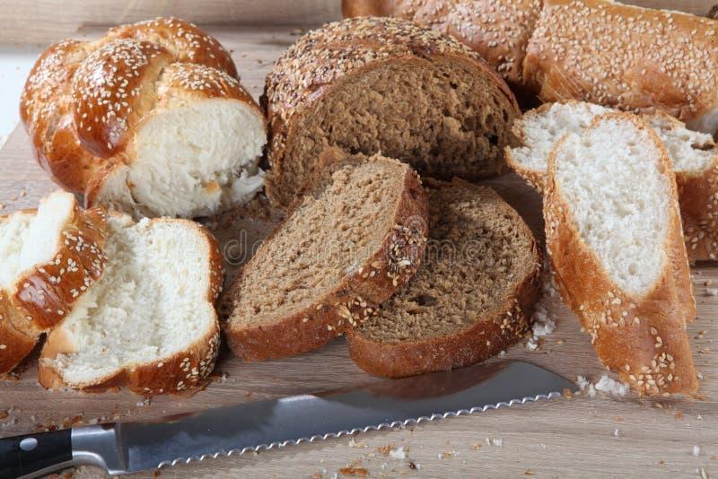 Skład z bochenkami chleb i rolki zdjęcia stock