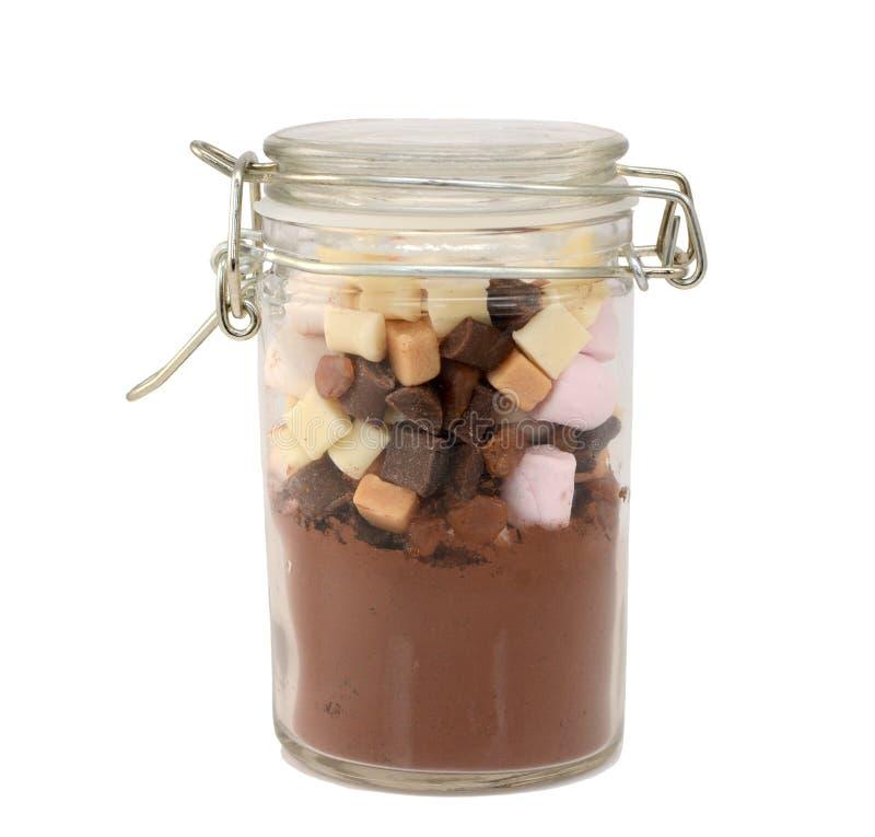 Składniki dla gorącej czekolady w szklanym słoju fotografia stock