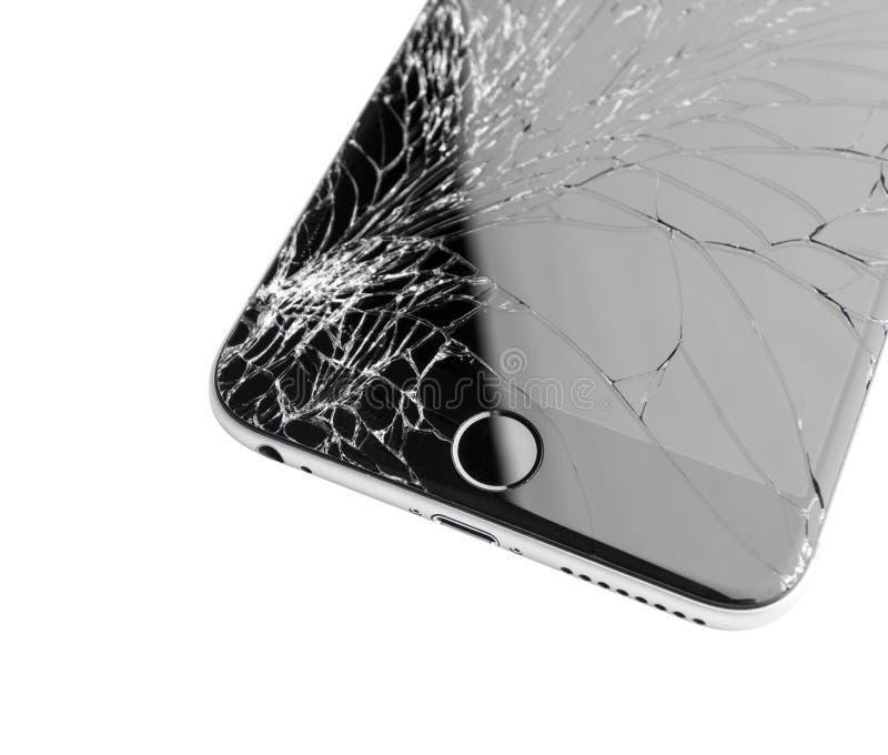 Skadad iphone på vit bakgrund royaltyfri fotografi