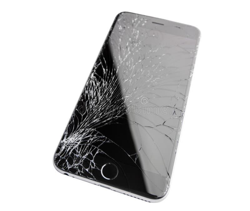 Skadad iphone på vit bakgrund royaltyfria foton