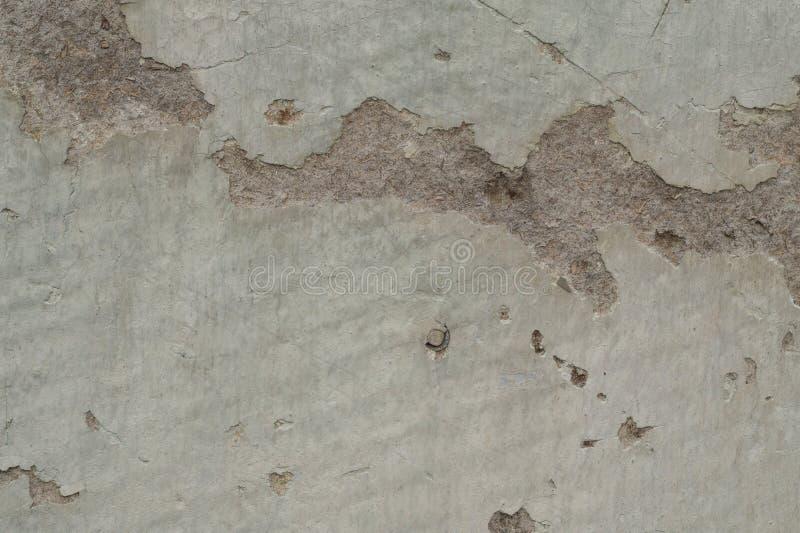 Skadad murbruk för gammal limefrukt på väggen av huset arkivfoton