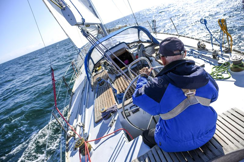 Skagen, Denmark, 31 July 2017: A lone sailor behind the helm on stock images