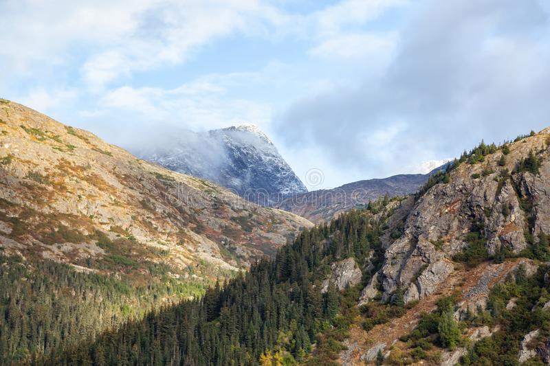 Skagway, Alaska, United States of America. Beautiful Natural American Mountain Landscape View during a cloudy and sunny summer morning royalty free stock image