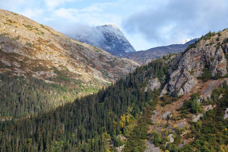 Skagway, Alaska, United States of America. Beautiful Natural American Mountain Landscape View during a cloudy and sunny summer morning royalty free stock photography