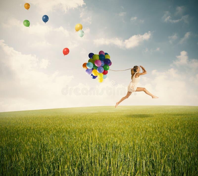Skakać z balonami zdjęcie royalty free