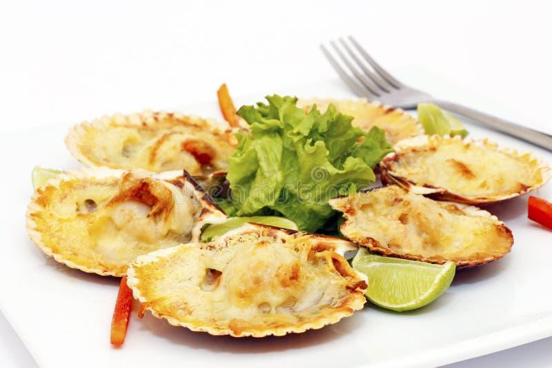 Skal med parmesanost - peruansk maträtt arkivfoton