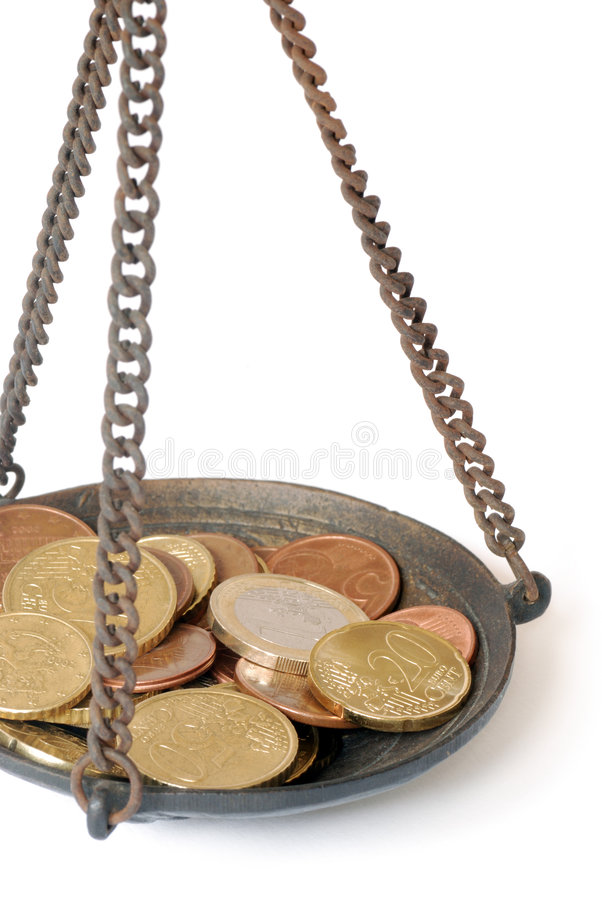 Skala mit Münze stockfoto