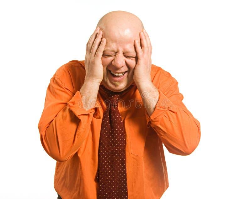 skallig skratta man royaltyfri foto