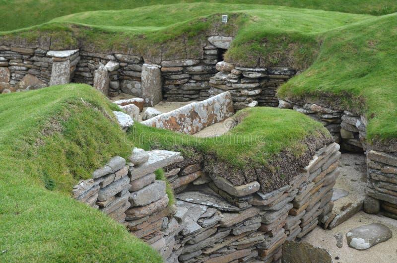 Skara Brae, uno stabilimento neolitico nella costa dell'isola del continente, Orkney, Scozia fotografia stock libera da diritti