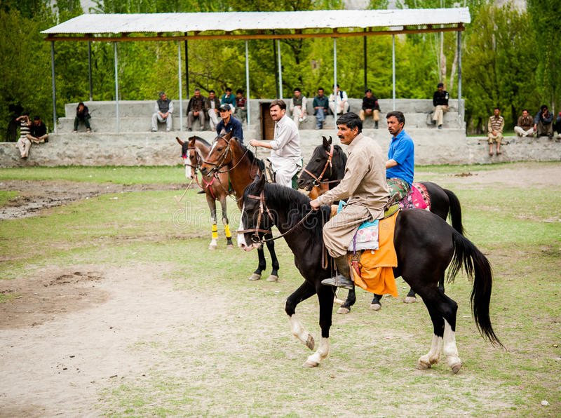 SKARDU, PAKISTAN - APRIL 18: An unidentified two man in a village in the south of Skardu, polo match on April 18, 2015 in Skardu,. Pakistan with a population of royalty free stock photos