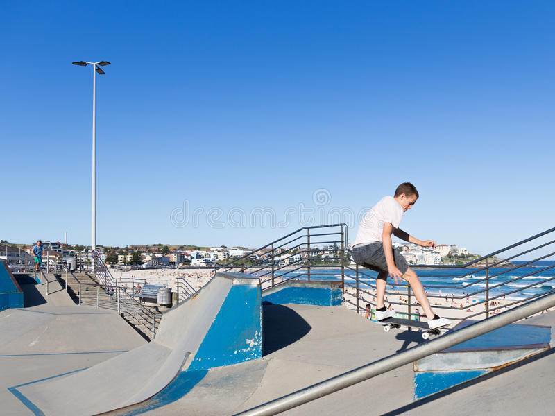 Skate boarder performs tricks stock images