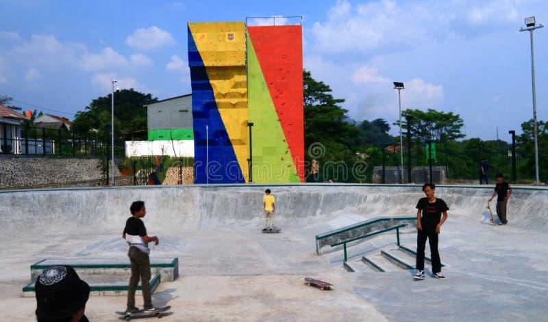 Skateboard at Alun-alun Depok. Depok, Indonesia - April 14, 2019: People play skateboard at Alun-alun Depok green open space in Grand Depok City, West Java stock image