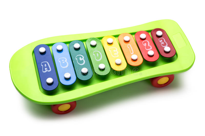 Skateboard colored toy xylophone on white background stock photo
