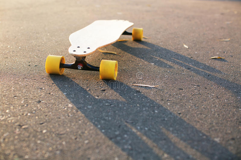 Skateboard on the ground. With shadow royalty free stock photos
